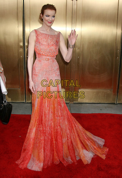 MARCIA CROSS.59th Annual Tony Awards held at Radio City Music Hall. .5th June 2005.USA, United States.Ref:Charles Harris/AdMedia.full length orange peach red belted high waisted floor length gown dress waving gesture posed.www.capitalpictures.com.sales@capitalpictures.com.© Capital Pictures.