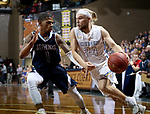 SIOUX FALLS, SD - MARCH 9:  Erich Erdman #24 From Briar Cliff drives against Philip Saunders #1 from St Thomas during their second round game at the 2018 NAIA DII Men's Basketball Championship at the Sanford Pentagon in Sioux Falls. (Photo by Dave Eggen/Inertia)