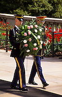 Guards carrying a  flower decoration in Arlington cemetery in Washington DC, USA