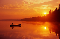 canoeing on Child's Lake at sunrise reflection<br /> Duck Mountain Provincial Park<br />