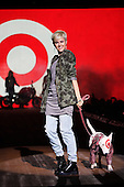 Quebec personality Genevieve Borne posing at the end of the catwalk with Target's mascot miniature Bull Terrier Bullseye
