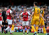 1st October 2017, Emirates Stadium, London, England; EPL Premier League Football, Arsenal versus Brighton; Alexis Sanchez of Arsenal has words with Lewis Dunk of Brighton after being fouled