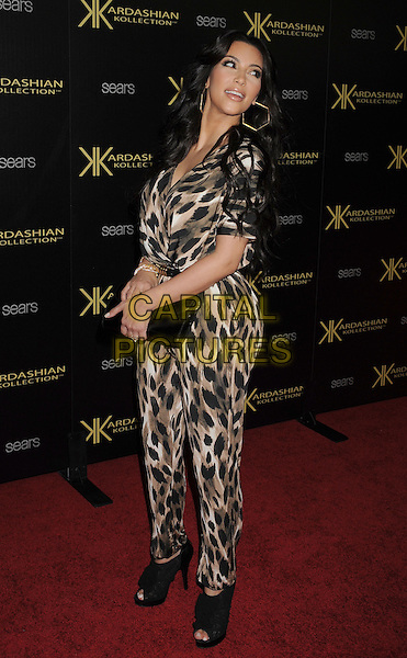 Kim Kardashian.The Launch Party for The Kardashian Kollection for Sears held at The Colony in Hollywood, California, USA..August 17th, 2011.full length black brown beige leopard print jumpsuit clutch bag open toe shoes ankle boots .CAP/ROT/TM.©Tony Michaels/Roth Stock/Capital Pictures