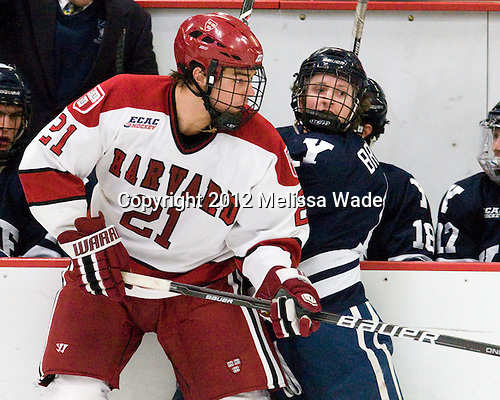 Marshall Everson (Harvard - 21), Charles Brockett (Yale - 11) - The Harvard University Crimson defeated the visiting Yale University Bulldogs 8-2 in the third game of their ECAC Quarterfinal matchup on Sunday, March 11, 2012, at Bright Hockey Center in Cambridge, Massachusetts.