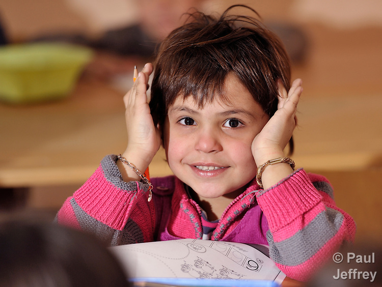 A girl in class at the Branko Pesic School, an educational center for Roma children and families in Belgrade, Serbia, which is supported by Church World Service. Many of the students' families came to Belgrade as refugees from Kosovo. Many of them lack legal status in Serbia, and thus have difficulty obtaining formal employment and accessing government services.
