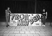 IRON MAIDEN - Nicko McBrain and Bruce Dickinson pose with the official advertising banner of the promoter of the band's concert in Poznan -Estrada Poznanska, at the start of the World Slavery Tour in Poznan Poland - August 1984.  Photo credit: George Bodnar Archive/IconicPix
