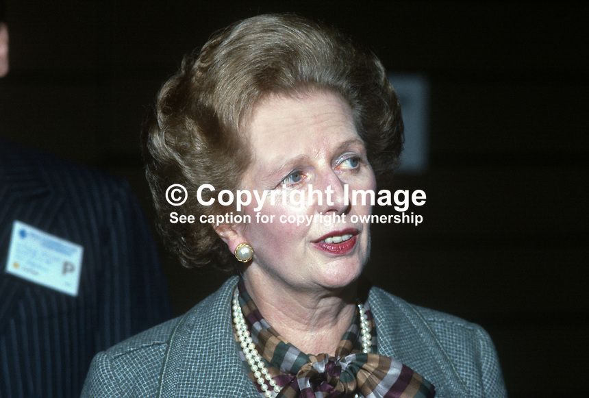 Only hours after surviving the Provisional IRA bombing of the Grand Hotel in Brighton, where she was staying, Margaret Thatcher, Prime Minister, UK, arrives at the Conservative Party's annual conference on Friday, 12th October 1984. 19840142MT6.<br /> <br /> Copyright Image from Victor Patterson, 54 Dorchester Park, Belfast, UK, BT9 6RJ<br /> <br /> t1: +44 28 9066 1296 (from Rep of Ireland 048 9066 1296)<br /> t2: +44 28 9002 2446 (from Rep of Ireland 048 9002 2446)<br /> m: +44 7802 353836<br /> <br /> victorpatterson@me.com<br /> www.victorpatterson.com<br /> <br /> Please see my Terms and Conditions of Use at victorpatterson.com . It is IMPORTANT that you familiarise yourself with them.<br /> <br /> Images used on the Internet incur an additional cost and must be visibly watermarked i.e. &copy;Victor Patterson within the body of the image and copyright metadata must not be deleted. Images used on the Internet have a size restriction of 4kbs and are chargeable at rates available at victorpatterson.com.<br /> <br /> This image is only available for the use of the download recipient i.e. television station, newspaper, magazine, book publisher, etc, and must not be passed on to any third party. It is also downloaded on condition that each and every usage is notified within 7 days to victorpatterson@me.com<br /> <br /> The right of Victor Patterson to be identified as the author is asserted in accordance with The Copyright Designs And Patents Act (1988). All moral rights are asserted.