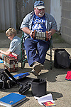 Man playing a squeeze box accordion playing traditional sea shanty music during a maritime day event, Woodbridge, Suffolk, England,