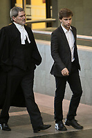 Gabriel Nadeau-Dubois walks with his lawyer at the Court house in Quebec city for his trial in contempt-of-court Thursday September 27, 2012. The former student spokesperson is accused of encouraging protesters to violate injunctions and preventing students from attending classes during a television interview last May.<br /> <br /> PHOTO :  Francis Vachon - Agence Quebec Presse