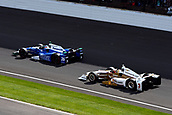 May 28th Indianapolis Speedway, Indiana, USA;  Takuma Sato, driver of the #26 Andretti Autosport Honda, and Helio Castroneves, driver of the #3 Team Penske Chevrolet, head through turn one on the cool down lap after Sato wins the Indianapolis 500 on May 28th, 2017, at the Indianapolis Motor Speedway in Indianapolis, Indiana.