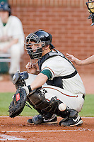 Catcher Kyle Skipworth #11 of the Greensboro Grasshoppers can't handle this wild pitch at NewBridge Bank Park April 15, 2010, in Greensboro, North Carolina.  Photo by Brian Westerholt / Four Seam Images