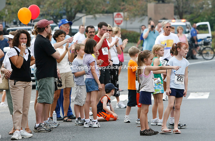 WATERBURY, CT, 09/14/08- 091308BZ11- Spectators watch finishers cross the line on Grand Street in Waterbury during the 3rd annual Bob Veillette 5K Road Race and Walk and Kids Fun Run Sunday afternoon. <br /> Jamison C. Bazinet Republican-American