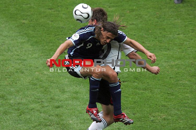 FIFA WM 2006 -  Quarter Finals / Viertelfinal<br /> Play   #57  (30-Jun) - Deutschland - Argentinien<br /> <br /> Hernan Crespo (vorne) von Argentinien im Kopfball Duell mit Bernd Schneider (hinten) von Deutschland.<br /> <br /> Foto &copy; nordphoto