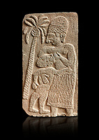 Pictures & images of the North Gate Hittite sculpture stele depicting a women breast feeding a child. 8the century BC.  Karatepe Aslantas Open-Air Museum (Karatepe-Aslantaş Açık Hava Müzesi), Osmaniye Province, Turkey. Against black background