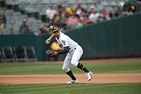 OAKLAND, CA - APRIL 4:  Chad Pinder #18 of the Oakland Athletics makes a play at third base against the Boston Red Sox during the game at the Oakland Coliseum on Thursday, April 4, 2019 in Oakland, California. (Photo by Brad Mangin)