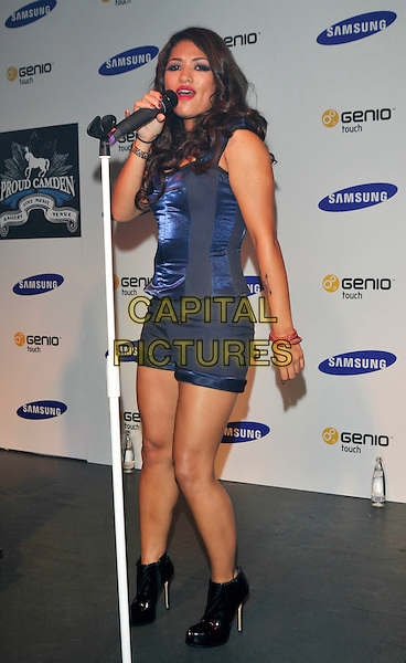 THE SATURDAYS - Vanessa White.Launch of the new mobile phone Samsung Genio Touch at Proud Camden, London, England..September 14th, 2009.stage concert live gig performance music full length blue corset top singing  ankle boots shorts  black.CAP/PL.©Phil Loftus/Capital Pictures.