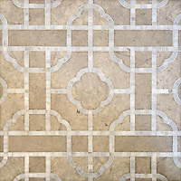 Royal Palace, a waterjet and hand-cut stone mosaic, shown in honed Palomar and polished Calacatta, is part of the Altimetry® Collection  design by Paul Schatz for New Ravenna.