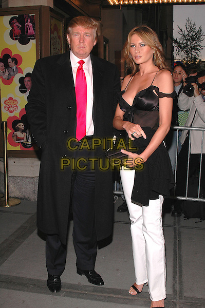 "DONALD TRUMP & MELANIA  KNAUSS.The premiere of the musical ""Sweet Charity"" on Broadway. .May 4th, 2005.Photo Credit: Patti Ouderkirk/AdMedia.full length married husband wife couple black coat white trousers black top .www.capitalpictures.com.sales@capitalpictures.com.© Capital Pictures."