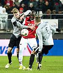 Nederland, Alkmaar, 19 januari  2013.Eredivisie.Seizoen 2012/2013.AZ-Vitesse 4-1.Jozy Altidore van AZ in duel om de bal met Marco van Ginkel van Vitesse en JAN-ARIE VAN DER HEIJDEN