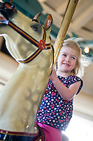 Emily Thomas on The Carousel at Pullen Park.