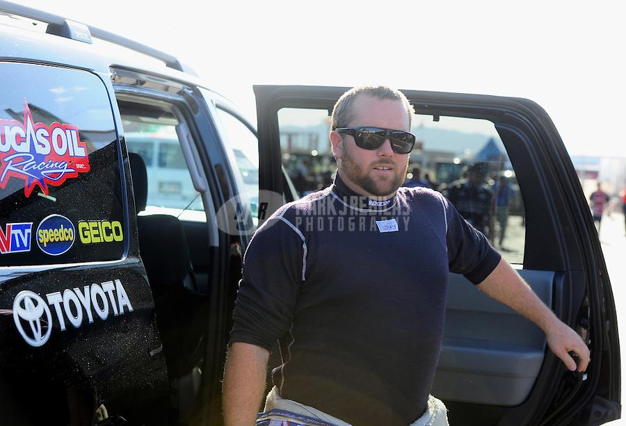 Oct. 14, 2011; Chandler, AZ, USA; NHRA top fuel dragster driver Shawn Langdon during qualifying at the Arizona Nationals at Firebird International Raceway. Mandatory Credit: Mark J. Rebilas-