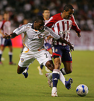 CD Chivas USA forward Maykel Galindo (11) beats LA Galaxy defender Mike Randolph (2) to the ball. CD Chivas USA defeated the LA Galaxy in the Super Clasico 3-0 at the Home Depot Center in Carson, CA, Thursday, September 13, 2007.