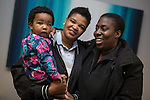 © Joel Goodman - 07973 332324 . 2 November 2013 . Levenshulme Inspire , Stockport Road , Manchester , UK . L-R daughter Myra Moroole (10 months) and partners and parents mum Regina Mensah (28) and mum Kele Moroole (29, from Levenshulme ) (all correct) enjoying children's facilities at the centre . The Levenshulme Inspire Community Centre celebrates its 3rd birthday and being awarded a 3-year lottery grant to enable the provision of new services for older residents . Photo credit : Joel Goodman
