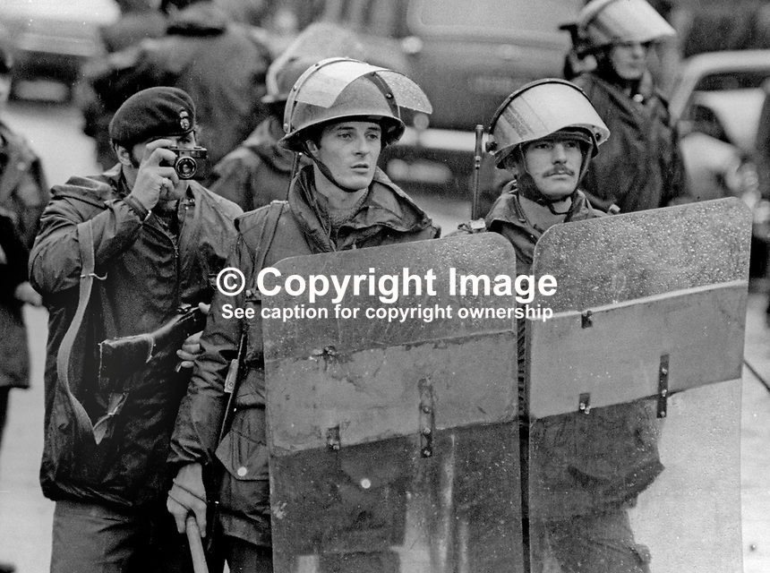 Peace People Parade along the Falls Road, Belfast, N Ireland, UK, 23rd October 1976 - soldiers were on duty to prevent serious violence by opponents of the march. One soldier is seen using a camera, not known whether he was using it officially for for personal reasons. 197610230506a <br /> <br /> Copyright Image from Victor Patterson, 54 Dorchester Park, Belfast, UK, BT9 6RJ<br /> <br /> t: +44 28 9066 1296<br /> m: +44 7802 353836<br /> <br /> e1: victorpatterson@me.com<br /> e2: victorpatterson@gmail.com<br /> <br /> IMPORTANT: My Terms and Conditions of Business are at www.victorpatterson.com