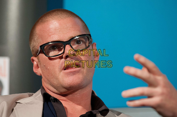 Heston Blumenthal.The Future of Food Q&A.  Experimental British chef and owner of the Fat Duck discusses the future of food, London Media Centre, London, England..August 10th, 2012.headshot portrait hand mouth open beige suit jacket blue top glasses   .CAP/BF.©Bob Fidgeon/Capital Pictures.