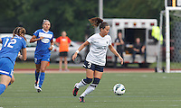 Seattle Reign FC defender Lauren Barnes (3) dribbles. In a National Women's Soccer League (NWSL) match, Seattle Reign FC (white) defeated Boston Breakers (blue), 2-1, at Dilboy Stadium on June 26, 2013.
