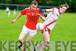 East Kerry's Kieran Murphy and An Ghealtacht's Caoimhghin O Beaglaoich go for the ball in the minor County championship final at Killorglin on Saturday.
