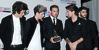 LOS ANGELES, CA - NOVEMBER 24: Harry Styles, Niall Horan, Liam Payne, Louis Tomlinson, Zayn Malik of One Direction in the press room at the 2013 American Music Awards held at Nokia Theatre L.A. Live on November 24, 2013 in Los Angeles, California. (Photo by Celebrity Monitor)