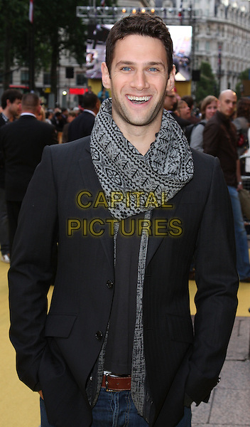 "JUSTIN BARTHA.UK Film Premiere of ""The Hangover"" at Vue West End Cinema, Leicester Square, London, England..June 10th, 2009.half length black jacket grey gray pattern scarf hands in pockets stubble facial hair .CAP/ROS.©Steve Ross/Capital Pictures."