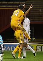 Keith Lasley climbs on Michael Higdon after scoring in the Motherwell v Aberdeen, Clydesdale Bank Scottish Premier League match at Fir Park, Motherwell on 26.12.12.