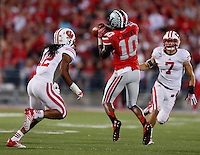 Ohio State Buckeyes wide receiver Philly Brown (10) leaps to catch a pass while defended by Wisconsin Badgers safety Dezmen Southward (12) during Saturday's NCAA Division I football game at Ohio Stadium in Columbus on September 28, 2013. (Barbara J. Perenic/Columbus Dispatch)