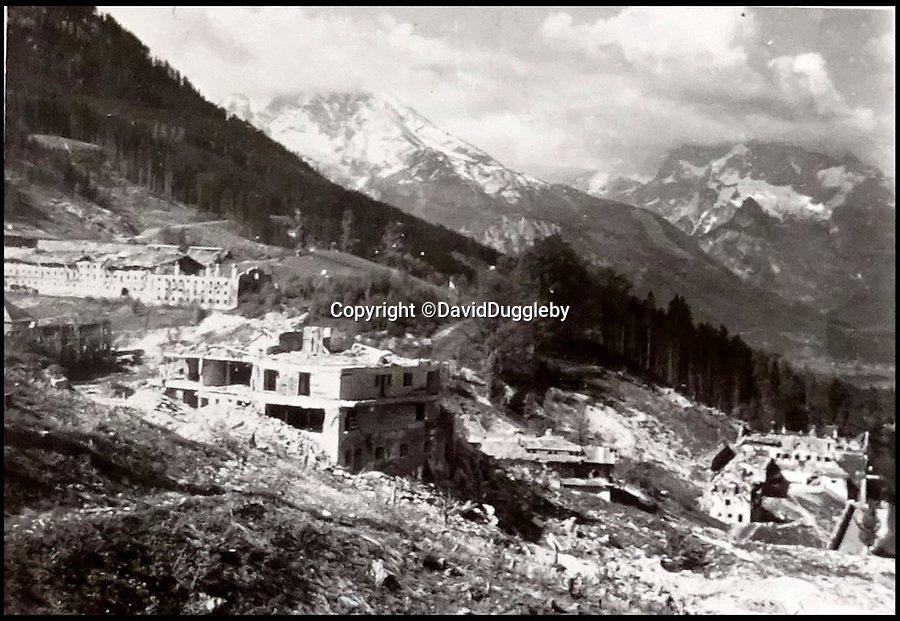 BNPS.co.uk (01202 558833)<br /> Pic: DavidDuggleby/BNPS<br /> <br /> Result - Berchtesgaden was flattened by the RAF's raid in April 1945.<br /> <br /> Secret rooms at a stately home where brilliant map-makers played a pivotal role in helping Britain to win the war have been opened to the public for the first time.<br /> <br /> Hughenden Manor, in Bucks, once home to the Victorian prime minster Benjamin Disraeli, was requisitioned by the Air Ministry in 1941 and given the codename 'Hillside'.<br /> <br /> In its confines, more than 3,500 hand drawn maps were produced for the RAF bombing campaigns, including the legendary Dambusters Raid and a raid on the Berchtesgaden, Hitler's famous mountain retreat.<br /> <br /> Previously hidden away under lock and key, these rooms have been opened for the first time for a permanent display featuring photographs, records and testimonies from some of the 100 men and women who were based there in World War Two.<br /> <br /> Since they were sworn to silence under the Official Secrets Act, Hillside's crucial wartime role in fact remained unknown until 2004, when a volunteer room guide overheard Victor Gregory, a visitor to the National Trust property, tell his grandson that he was stationed there during the war.