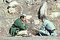 Iran 1979.Headquarters of KDPI near the Iraqi border: Mullah Mohamed ( left )  discussing with the treasurer