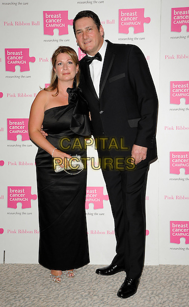 GUEST & TONY HADLEY .At the Breast Cancer Campaign Pink Ribbon Ball, The Dorchester, London, England, UK, October 9th 2010..full length black strapless dress tuxedo tux bow tie .CAP/CAN.©Can Nguyen/Capital Pictures.
