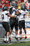 Southern Utah's Chris Robinson (6) celebrates his touchdown against Nevada with teammates Mitch Jessop (13) and Chandler Allphin (19) during the second half of an NCAA college football game on Saturday, Aug. 30, 2014 in Reno, Nev. Nevada defeated Southern Utah 28-19. (AP Photo/Cathleen Allison)