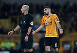 Referee Mike Dean is questioned by Ruben Neves of Wolverhampton Wanderers during the Premier League match at Molineux, Wolverhampton. Picture date: 14th February 2020. Picture credit should read: Darren Staples/Sportimage