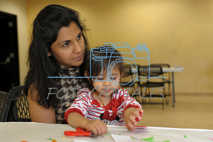 Manisha Martinez and her daughter Adi, 1, of Sparks sit at a craft table during Nevada Wildflower Family Fun Day at the Nevada State Museum in Carson City Saturday April 11, 2015. Visitors to the museum were treated to loads of information, hands-on experiences and crafts.<br /> Photo by Lisa J. Tolda