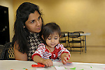 Manisha Martinez and her daughter Adi, 1, of Sparks sit at a craft table during Nevada Wildflower Family Fun Day at the Nevada State Museum in Carson City Saturday April 11, 2015. Visitors to the museum were treated to loads of information, hands-on experiences and crafts.<br />