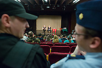 Sci-fi fans dressed in military uniforms listen as US actor John de Lancie (L in the back) talks on stage during a meeting with his fans in Budapest, Hungary on January 11, 2015. ATTILA VOLGYI