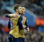 Arsenal goalscorer Aaron Ramsey (left) celebrates with provider Mesut Ozil -  Football - Barclays Premier League - Aston Villa vs Arsenal - Villa Park Birmingham - 13th December 2015 - Season 2015/2016 - Photo Malcolm Couzens/Sportimage