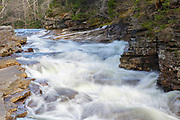 Lower Ammonoosuc Falls in Carroll, New Hampshire during the spring months. This waterfall is located on the Ammonoosuc River.