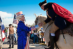 Uncle Sam and George Washington shake hands at the North Houston Tea Party Rally at Sam Houston Race Park.