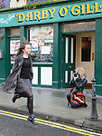 A photographer pictures Amy Moroney dancing on Laurence street for the visit of Fleadh Ceol Ard Comhairle to assess Drogheda in its bid to host the Fleadh Ceol 2015. Photo:Colin Bell/pressphotos.ie