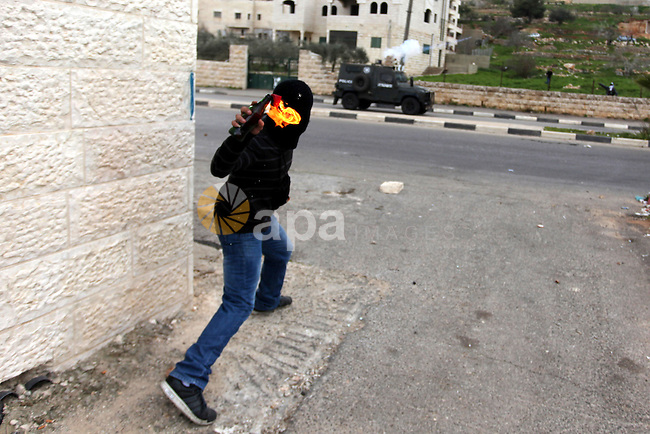 A Palestinian protester throws a molotov cocktail at Israeli security forces during clashes near Israeli military prison Ofer, south of the West Bank city of Ramallah, 28 February 2013. Hunger strikes by Palestinians in Israeli prisons have sparked clashes throughout the West Bank. On 23 February, a Palestinian detained for hurling a rock that injured an Israeli died in custody, further fuelling Palestinian anger. Palestinian hunger striker Samer Issawi has been transferred from an Israeli prison clinic to a civilian hospital near Tel Aviv, amid concerns that his health was deteriorating, according to reports 28 February. Photo by Issam Rimawi