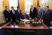 "United States President Bill Clinton signs an executive order increasing seatbelt use in the USA in the Oval Office of the White House in Washington, DC on April 16, 1997.  From left to right: former Secretary of Transportation Andrew ""Andy"" Card, former Secretary of Transportation Federico Peña,  current Secretary of Transportation, Rodney Slater, President Clinton, former Secretary of Transportation Alan Boyd, former Secretary of Transportation Samuel Skinner,  and former Secretary of Transportation William T. Coleman Jr. look on. <br /> Mandatory Credit:  Barbara Kinney / White House via CNP"