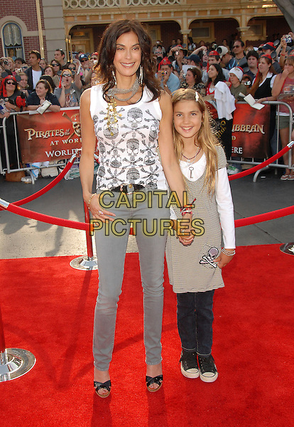 "TERI HATCHER & daughter Emerson.Attends The Walt Disney Pictures' World Premiere of ""Pirates of The Caribbean: At World's End"" held at Disneyland in Anaheim, California, USA, May 19 2007..full length silver necklace earrings white skull and crossbones vest top grey skinny jeans black wooden heel shoes holding hand family mother mom child kid.CAP/DVS.©Debbie VanStory/Capital Pictures"